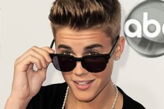 Justin Bieber appears to be smoking pot in party pictures