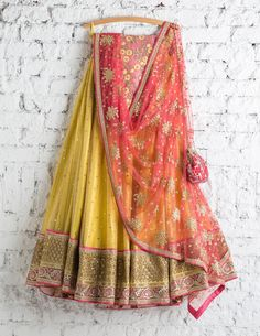 Buy yellow color with pleasing embroidery & resham work designer lehenga choli online.This set is features a pink blouse in silk fully embellished with booty, resham and sequins work.It has matching yellow lehenga in net with beautiful embroidery all Indian Bridal Lehenga, Red Lehenga, Yellow Lehenga, Pakistani Bridal, Indian Attire, Indian Ethnic Wear, Indian Dresses, Indian Outfits, Indian Clothes