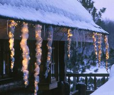 Outdoor Holiday Decorating with Glowing Icicles made with window screen and plastic wrap adorned with white lights and baubles. ♥