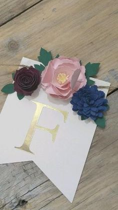 Personalize this beautiful, floral banner with a name or wording of your choice. It makes a unique gift for a mom-to-be and her new baby's nursery. Or hang it at a bridal shower for the Future Mrs. Each pennant features three beautiful, hand-crafted paper flowers, gold leaves and rose gold lettering. Paper Flower Garlands, Paper Flower Backdrop, Paper Flowers, Burlap Invitations, Navy Blue Flowers, Brown Curtains, Floral Banners, Cricut Ideas, Floral Arrangements