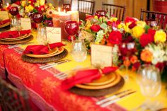 Surprise Birthday Party by St. Louis Wedding Consultants. Beautiful table! I LOVE colored glasses! #wineglass #richcolors #redglasses www.stlweddingconsultants.net