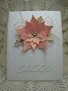 handmade Christmas card ... Pink Poinsettia die cut with Spellbinder's die and brushed with gold ... luv the random dots of the the embossing folder background ... gorgeous!