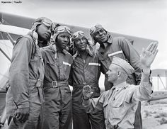 Members of the U.S. Army Air Corps' legendary 99th Pursuit Squadron, the Tuskegee Airmen, receive instruction about wind currents from a lieutenant in 1942. /Gabriel Benzur  #photography #war #history #blackandwhite