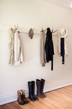 hubby has some antlers that he wants displayed maybe if they were painted and used like this I could stand it