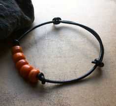 black leather bracelet orange beads / halloween. $15.00, via Etsy.