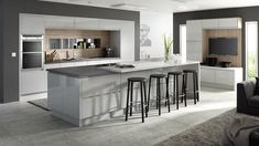 Gloss Kitchen in Light Grey. The integrated 'J-pull' handle on this gloss light grey kitchen is extremely popular at the moment. See more gloss kitchens with integrated handles at http://www.mackintoshkitchens.co.uk/kitchens?category%5B%5D=modern&finish%5B%5D=Gloss&style%5B%5D=Integrated+Handle