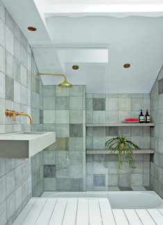 A Variety Of Similar Blue Grey Tiles Creates Calm Watery Feel In This