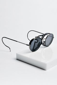 TRENDING: Thom Browne round sunnies inspired by John Lennon. Thom Browne Eyewear, Thom Browne Sunglasses, Lunette Style, Mens Glasses, Mode Style, Ray Ban Sunglasses, Eyeglasses, Fashion Accessories, Sunglasses Accessories