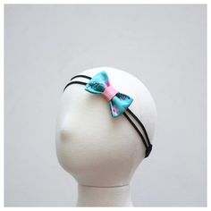 Please read the entire description thoroughly prior to purchasing. Floral print fabric bow with pink leather accent and suede bands. Headband has an elastic str