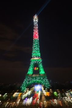 The Eiffel tower is lit up in the colors representing Portugal Tour Eiffel, Benfica Wallpaper, Portugal, We Are The Champions, 2016 Pictures, World Football, European Championships, Paris France, Tower