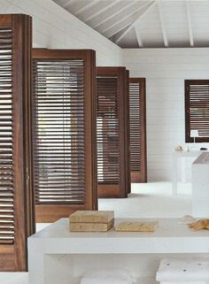 Raw timber shutters on white