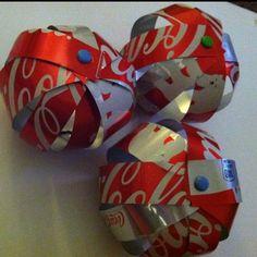 DIY coca-cola can ornaments http://en.espritcabane.com/celebrations/christmas-balls.php for instructions