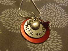 Beautiful Teacher Gift: Customized Metal Stamped Teacher Necklace with Red Bell. Best part? It's made by a teacher! What a wonderful gift for you child's teacher, a colleague or even yourself!