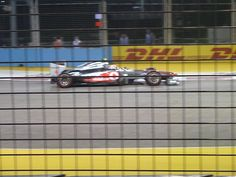 Best I could do with a 16x zoom digital camera through a fence at a car doing over 150kph