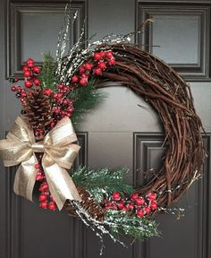 Rustic Christmas wreath with gold bow, red berries, greenery and pinecones; monogram wreath by SimpleWreath on Etsy https://www.etsy.com/listing/247836436/rustic-christmas-wreath-with-gold-bow