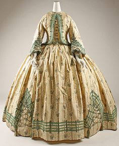 Date:      ca. 1862  Culture:      French  Medium:      silk  Dimensions:      Length at CB (bolero): 19 in. (48.3 cm) Length at CF (skirt and bodice): 55 1/4 in. (140.3 cm)