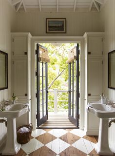 Checker painted floors and french doors in this charming bathroom. That art above the doorway is everything. House Tour: Historic Beauty in Mill Valley - Design Chic. Bad Inspiration, Bathroom Inspiration, Bathroom Pictures, Painted Floors, Beautiful Bathrooms, Cheap Home Decor, Home Decor Accessories, House Tours, Home Remodeling