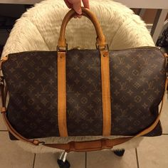 Authentic Louis Vuitton Bandouliere Keepall 50 Authentic Louis Vuitton Keepall 50 Travel Duffle Bag. In good shape. Shows some signs of wear. Inside is clean NO STAINS. Date code V.I 8910. Comes with strap no dust bag. I sold the dust bag separately a couple months ago. Over all, great bag for traveling it's a decent size. Louis Vuitton Bags Travel Bags