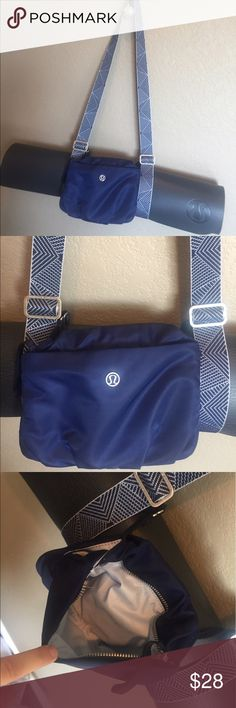 Lululemon Essential Mat Carrier Bag Straps strap This is a gently used Lululemon Mat Carrier with pretty embroidered strap. I would say color is a deep blue with just a hint of purple. This bag is perfect if you want to skip the locker room at yoga, kick off your shoes and head in. There are a few minor signs of wear, if you look close at nylon you can see some small watermarks, a few marks inside (see close up) and some discoloration on interior of straps. Straps adjust to fit any size Mat…