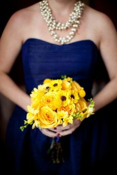 Blue and yellow ...love the pearls with the navy dress