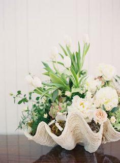 Flowers in Oyster Shells #weddingdecor