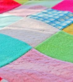 patchwork blanket of old felted sweaters.  good idea.