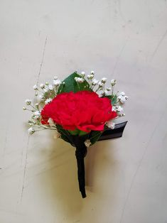 Red Carnations, baby's breath, and greens with black trim. Carnation Boutonniere, Boutonnieres, Brownwood Tx, Red Carnation, Local Florist, Baby's Breath, Corsages, Flower Delivery, Black Trim