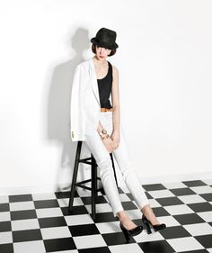 Model Wearing White Suit and Black Hat