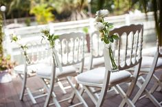 Vintage wooden chairs can add a rustic touch to a modern day wedding. Hotel Fort Canning.