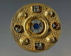 Gold buckle engraved and set with precious stones from Castle Trosino, Italy; Lombard era, 7th century CE.