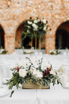 lush organic centerpiece of white spray roses, burgundy snapdragons, white mums, almond tree blossoms, privet berry, seeded eucalyptus and greenery in wood boxes at casa feliz.