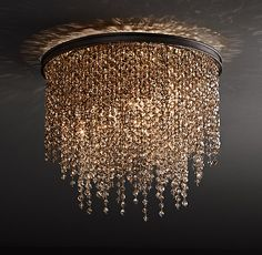 RH TEEN's Athena Crystal Flushmount Smoke:Our Athena Crystal Flushmount adds unabashed drama to any room. Its opulent, tiered design sparkles with dripping strands of elegant crystal beads.