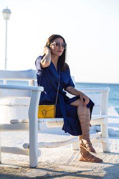 Stella Asteria wearing blue dress