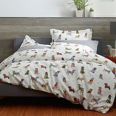 """Quinn loves this for her master bedding- it is very """"her""""- fun and crazy, dogs wearing cute hats and scarves!"""