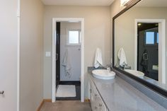 An ensuite master bath has a separate shower room and a large vanity area.