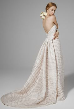 Brides: Peter Langner. Strapless mermaid gown featuring linen folded bands with nude under layer.