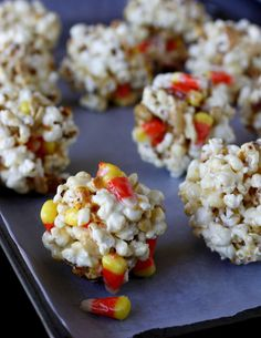 Use candy corn + salted peanuts to make yummy, gooey Popcorn Balls. Thanksgiving Recipes, Fall Recipes, Holiday Recipes, Great Recipes, Favorite Recipes, Holiday Ideas, Popcorn Recipes, Candy Recipes, Halloween Sweets