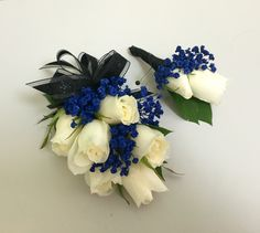 Navy blue and white wrist corsage and boutonnière. Prom 2016