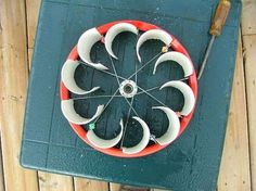 This turbine is made by cutting apart PVC pipes so that the halves are ...