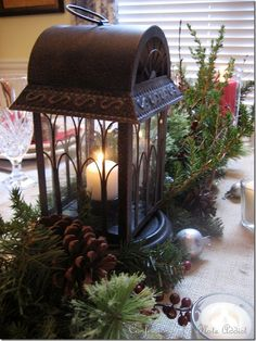 lantern+christmas+tablescape | At the center is a lantern with Gothic window glass…one of my ...