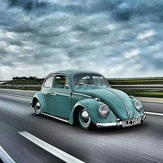 Volkswagen VW. (Nice picture, the sky and beetle go well together.)