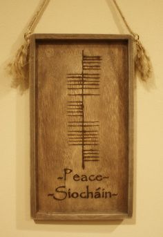 Ogham plaque. Rustic handmade hanging inspirational plaque written in ancient Irish Ogham alphabet of ancient Ireland.