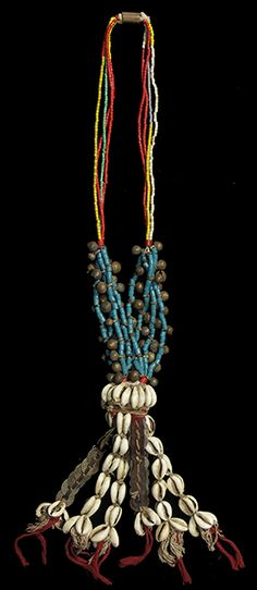 """FULANI Necklace 18 23"""" high x 7"""" wide $125 The Fulani, many of whom are nomadic, live in an area from Mali in the west to Cameroon in the east.  The necklaces show an inventive combination of beads, chain metalwork, small cast pieces and British West African coins."""