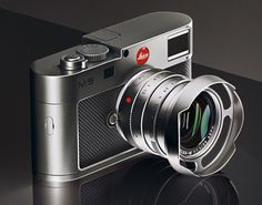 This beauty is a colaboration of Leica and Walter deSilva from the Volkswagen Group. The lead designer and his Audi Design Team have re-designed the LEICA all the exterior metal components are manufactured from solid titanium and complemented by Leica Camera, Rangefinder Camera, Leica M, Camera Gear, Film Camera, Old Cameras, Vintage Cameras, Canon Cameras, Tatoo