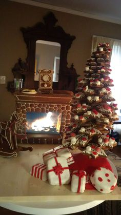 Gingerbread creation for 2015.   Samsung tablet (5x8 screen) supplies the fire in this 21x24 inch gingerbread display.  36 individual pieces make up the tree.  All elements custom designed and cut