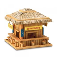 Beach Hangout Birdhouse birdies will belly up to this adorable wood snack shack! Just like a favorite seaside hangout, complete with straw roof, signs and barstool perches. 8 x 8 x 7 high. Wooden Bird Houses, Decorative Bird Houses, Carpenter Bee Trap, Bee Traps, Tiki Hut, Backyard Farming, Tropical Birds, Handmade Decorations, Bars For Home