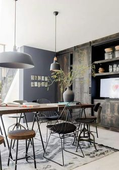 Industrial design, modern furnishings, wood furniture, light color palette, accent chairs, pendant lighting, patterned rug