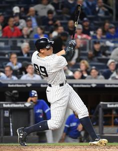 New York Yankees rightfielder Aaron Judge hits a solo home run against the Toronto Blue Jays during the third inning in an MLB baseball game at Yankee Stadium on Tuesday, May 2, 2017.