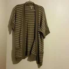Cardigan shrug Cardigan sweater shrug, two tone light brown, has belt loops but no belt. Worn a couple of times. Art and Soul Sweaters Shrugs & Ponchos