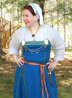 My latest Viking garb: linen gown, wool apron dress with tablet woven band and documented contrast embroidery. I made the glass beads and wove the wire strand and Inkle-loomed belt. I did not make the tablet weave. Coif embroidered with an Irish motif.